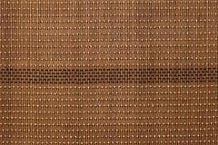 Plan rapproché en bambou de texture de tapis de Brown Image stock