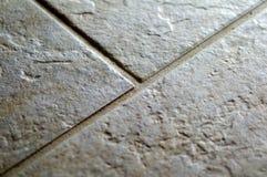 Plan rapproché en céramique de plancher de tuile de roche image libre de droits