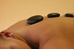 Plan rapproché en pierre chaud de massage Image stock