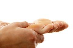 Plan rapproché femelle de pied de massage d'isolement sur le blanc Photographie stock