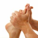Plan rapproché femelle de pied de massage d'isolement sur le blanc image stock