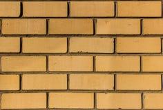Plan rapproché jaune de mur de briques de silicate Images stock