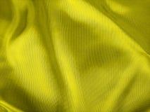 Plan rapproché jaune de tissu Image libre de droits