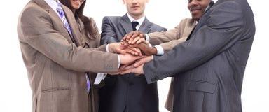 Plan rapproché - mains des hommes d'affaires empilés ensemble Image libre de droits