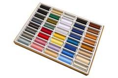Plan rapproché multicolore de fond d'amorçages de couture Photo stock