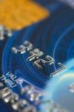 Plan rapproché par la carte de crédit de chiffres. Photo libre de droits