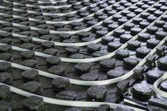 Plan rapproché rayonnant d'installation de chauffage par le sol Images stock