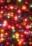 Plan rapproché rougeoyant d'étoiles d'arbre de Noël Photo libre de droits