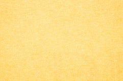 Plan rapproché un fond de papier jaune de texture Images stock