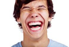 Plan rapproché adolescent heureux de rire Images stock