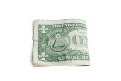 Plan rapproché des dollars de papier dans l'agrafe au-dessus du fond blanc Image stock