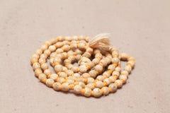 Plan rapproché des perles roulées de chant Photo stock