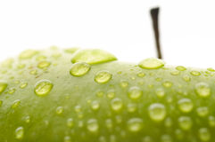 Plan rapproché humide de pomme Images stock