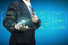 Plan of soccer manager pointing to strategy tactical Royalty Free Stock Images
