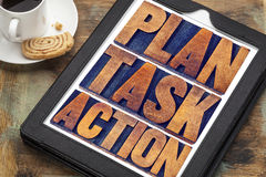 Plan, task, action words on tablet Royalty Free Stock Images