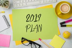 2019 plan text on colorful paper memo note with business office. Accessories. Top view from above royalty free stock photo