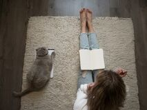 Plan Things, Set Goals. A Young Woman Sits On The Floor On The Carpet And Writes In A Diary. Stock Images