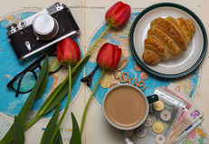 Plan of trip. Background - what to take for a trip. map, retro camera, money, coins, croissant, coffee, tulips, love, Eiffel Tower, sunglasses Stock Photography