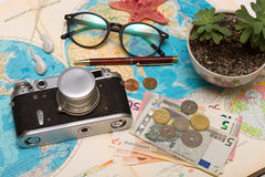 Plan of trip. Background - what to take for a trip. map, retro camera, money, sunglasses, coins, headphones Royalty Free Stock Photo