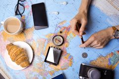 Plan of trip. Background - Women`s hands and map, retro camera, money, compass Royalty Free Stock Photos