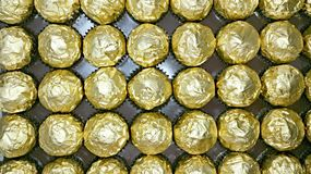 Plan view of golden foil wrappers Stock Photos