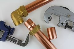 Plumbing. A plan view of plumbing tools and pipework/fittings royalty free stock photography