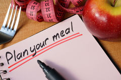 Plan your meal. Diary with a record plan your meal on a table Royalty Free Stock Image