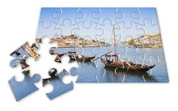 Plan your portuguese holiday - Concept in puzzle shape - Typical portuguese boats used in the past to transport the famous port royalty free stock photo