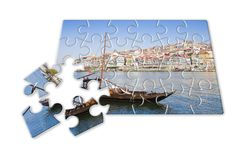 Plan your portuguese holiday - Concept in puzzle shape - Typical. Portuguese boats used in the past to transport the famous port wine stock photography