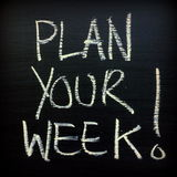 Plan Your Week!. The words Plan Your Week written by hand on a blackboard as a reminder to organize your time for greater productivity stock photography