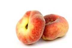 plana nya persikor två för färgrik munk Arkivbilder