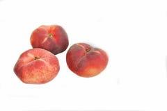 Plana persikafrukter arkivbilder