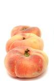 plana persikor Arkivbild