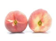 plana persikor på bakgrunden Royaltyfri Foto