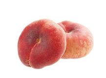Plana persikor som isoleras på vit Royaltyfria Foton