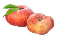 Plana persikor som isoleras på viten Arkivfoton