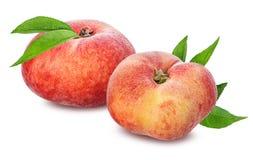 Plana persikor som isoleras på viten Royaltyfria Bilder
