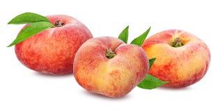 Plana persikor som isoleras på viten Royaltyfria Foton