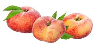 Plana persikor som isoleras på viten Arkivfoto