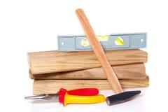 Plance di legno con gli strumenti del lavoro Immagine Stock