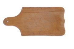 Planche à découper en bois sur un fond blanc Photos stock