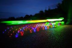 Planche à roulettes d'éclairage dans le mouvement Image libre de droits