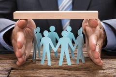 Planche de Covering Paper Team With Hands And Wooden d'homme d'affaires photo libre de droits
