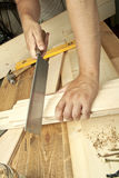Planche de sawing d'homme Photo stock
