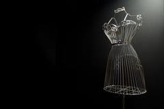 Planche el vestido en un fondo negro imágenes de archivo libres de regalías