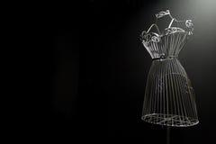 Planche el vestido en un fondo negro Foto de archivo libre de regalías