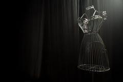 Planche el vestido en un fondo negro imagen de archivo libre de regalías