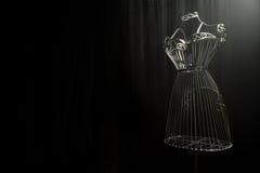 Planche el vestido en un fondo negro fotografía de archivo libre de regalías