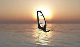 Planche à voile dans le coucher du soleil Image stock