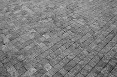 Plancher d'une rue avec les tuiles en pierre Image stock
